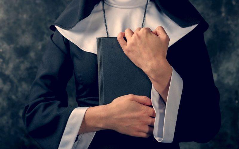 Nun holding bible